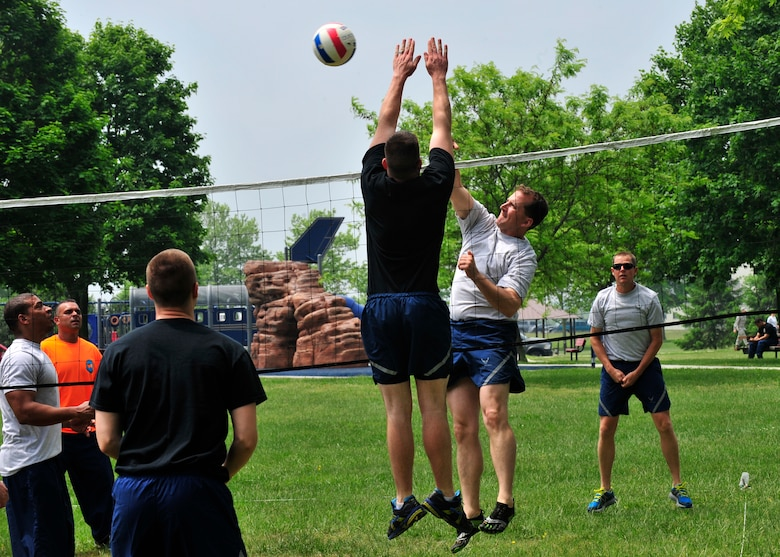 Airmen from Team Dover compete in the volleyball competition during Wingman Day May 22, 2014, at the Eagles Nest Park on Dover Air Force Base, Del. Rally point scoring was used to expedite the games. (U.S. Air Force photo/Staff Sgt. Elizabeth Morris)