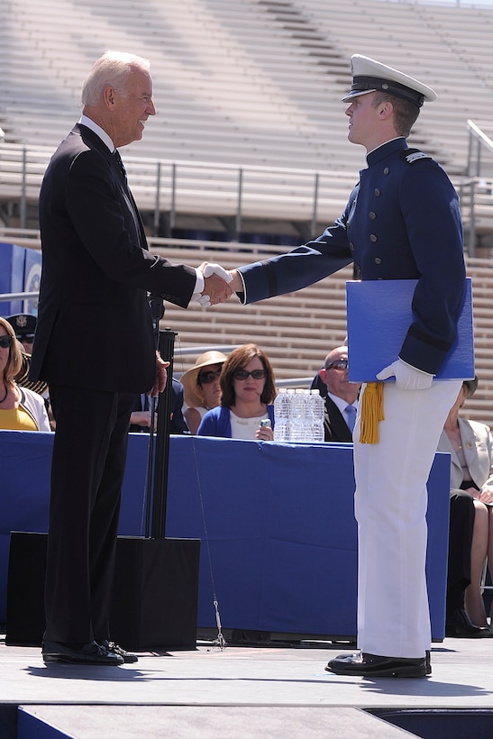 Senior David McCarthy receives his diploma from Vice President Joe Biden during the U.S. Air Force Academy Class of 2014 during commencement exercises at Falcon Stadium in Colorado Springs, Colo. May 28, 2014.  Cadet McCarthy was the  top cadet  in the class of 995 cadets who will receive their commission.  (Air Force photo/ Sarah Chambers)