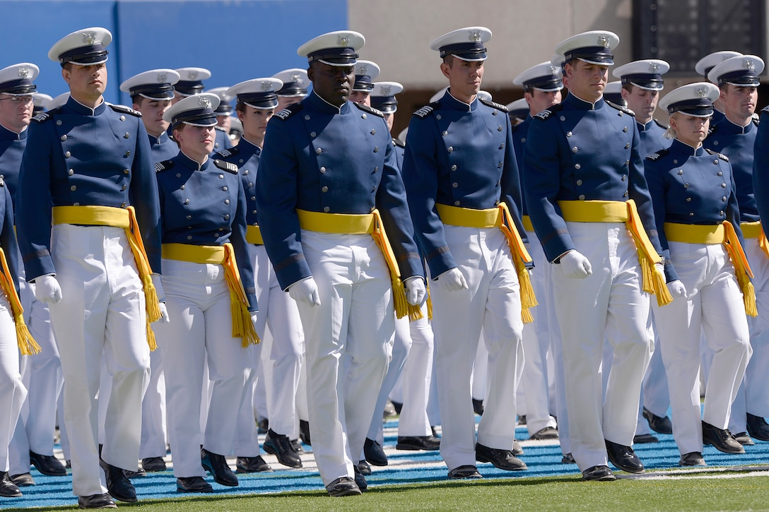 The U.S. Air Force Academy Class of 2014 marches into Falcon Stadium during commencement exercises in Colorado Springs, Colo. May 28, 2014.  A total of 995 cadets will receive their commission.  (Air Force photo/ Mike Kaplan)