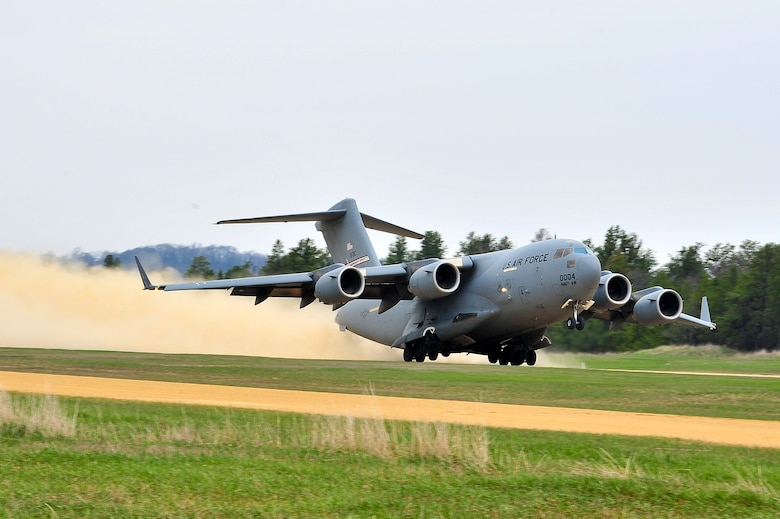 A 445th Airlift Wing C-17 Globemaster III takes off from the Young Air Assault Strip on May 7, 2014 during exercise Patriot Warrior at Fort McCoy, Wis. United States military reserve components from all branches participate in combined exercises Patriot Warrior, Global Medic, Diamond Saber and CSTX in preparation for upcoming deployments in joint environments. (U.S. Air Force photo by Master Sgt. Francisco V. Govea II/ Released)