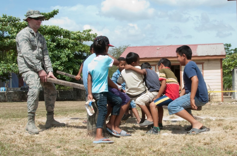 U.S. Air Force Chaplain (Capt.) Matthew Clouse, right, plays on a seesaw with Belizean children while they wait with their parents to receive medical care during a New Horizons Belize 2014 medical readiness training exercise, or MEDRETE, April 11, 2014, in Progresso, Belize. Clouse is supporting service members of New Horizons Belize 2014 as the team's chaplain. He is charged with meeting the spiritual needs of the more than 400 U.S. military members deployed in support of the exercise. (U.S. Air Force photo by Tech. Sgt. Kali L. Gradishar/Released)
