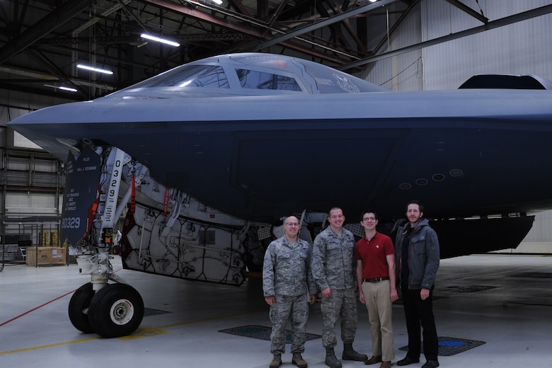 2nd Lt. Curan Clonch (left center) poses in front of a B-2 bomber at Whiteman Air Force Base, Missouri.  (U.S. Air Force courtesy photo)