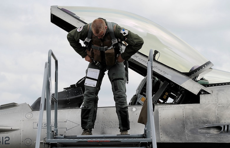 U.S. Air Force Capt. Casey Manning, F-16 Fighting Falcon fighter aircraft pilot from Spangdahlem Air Base, Germany, performs post-flight procedures shortly after arriving at this year's Berlin Trade and Air Show, Berlin, May 20, 2014. The U.S. aircraft on the ramp were open for spectators and vendors within the aerospace industry to observe and interact with all crew members who not only operate the aircraft, but also maintain them. (U.S. Air Force photo by 2nd Lt. Clay Lancaster/Released)