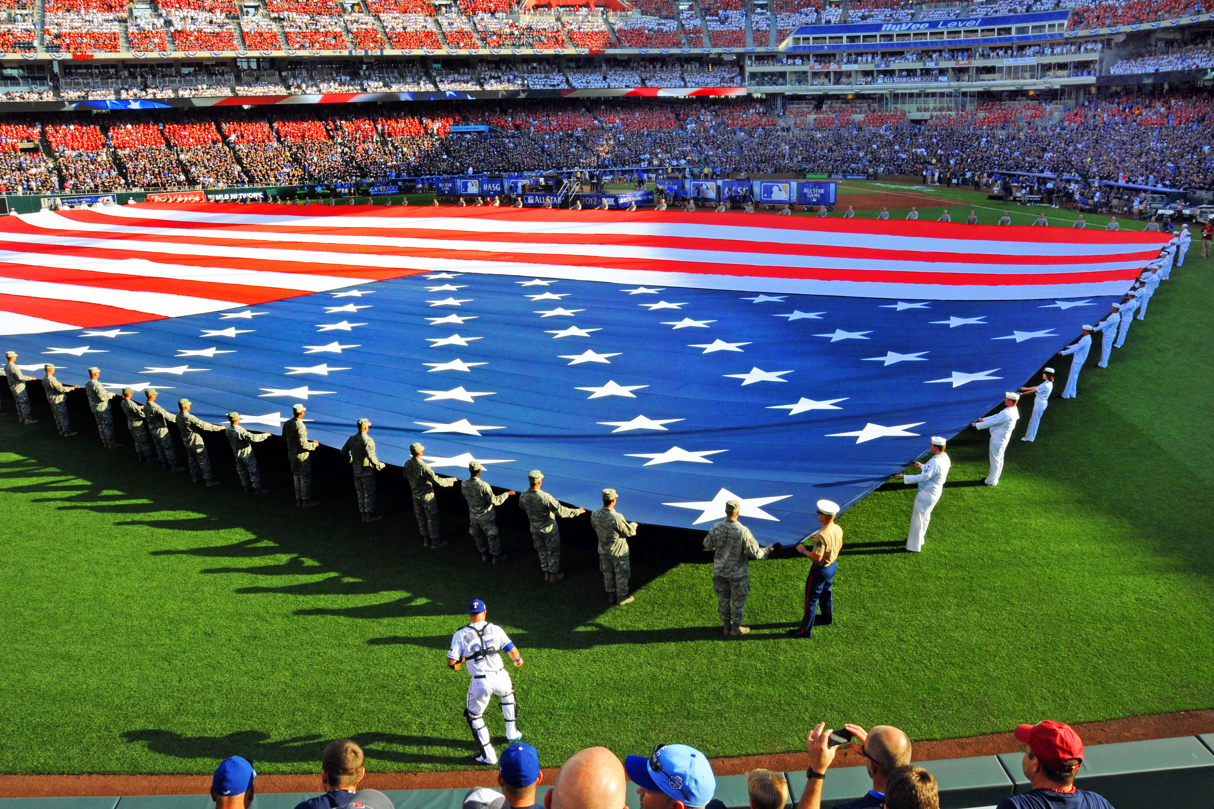 Sailors And Airmen Present A Giant American Flag Before The 2012 Major  League Baseball All