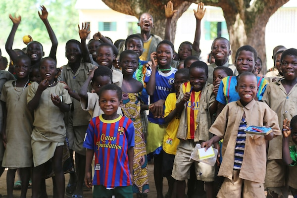Students in the village of Atome, Togo, look forward to receiving their new school as a gift from the people of the U.S., in late 2014. The U.S. Embassy in Lome, U.S. Africa Command and U.S. Army Corps of Engineers Europe District partnered to deliver six new schools to the children of Togo. The projects are being executed through the Department of Defense's AFRICOM humanitarian assistance program to improve future prospects for Togolese youth.
