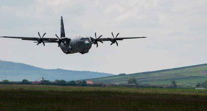 A C-130J Super Hercules from the 37th Airlift Squadron performs a touch and go during Carpathian Spring 2014, May 18, 2014, Campia Turzii, Romania. During the two-week-long training, pilots were able to utilize the less restrictive airspace, allowing them to perform low-level and night vision flights. (U.S. Air Force photo/Senior Airman Damon Kasberg)