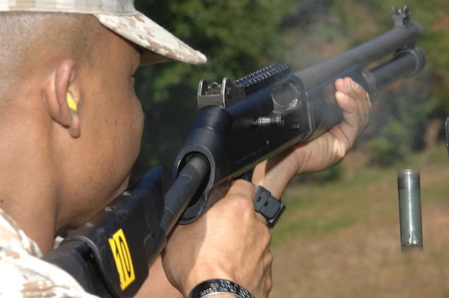 A Marine fires a M1014 semi-automatic shotgun during the Marine Corps Police Department's marksmanship qualification course at the Base Pistol Range, recently. The course is part of the Security Augment Force training hosted by the MCPD.