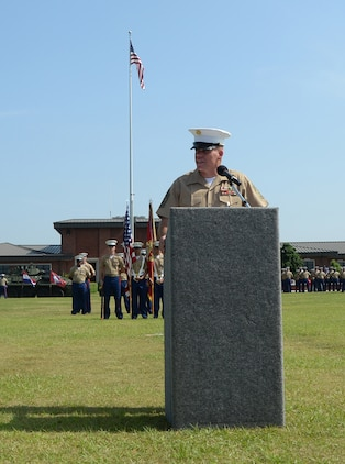 Sgt. Maj. Conrad E. Potts, outgoing sergeant major, Marine Corps Logistics Base Albany, speaks to the audience during his retirement ceremony held on Schmid Field, May 23.