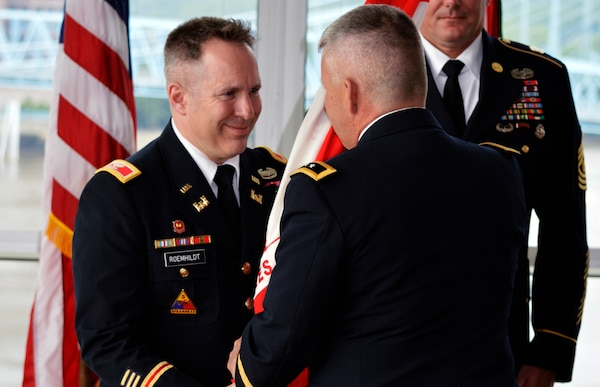 Maj. Gen. Todd Semonite (Right), U.S. Army Corps of Engineers deputy chief of Engineers, transfers command of the Great Lakes and Ohio River Division to Col. Steven J. Roemhildt during a change of command ceremony May 28, 2014 at the Great American Ballpark Riverfront Club in Cincinnati, Ohio.  Roemhildt took command from Brig. Gen. Margaret Burcham.
