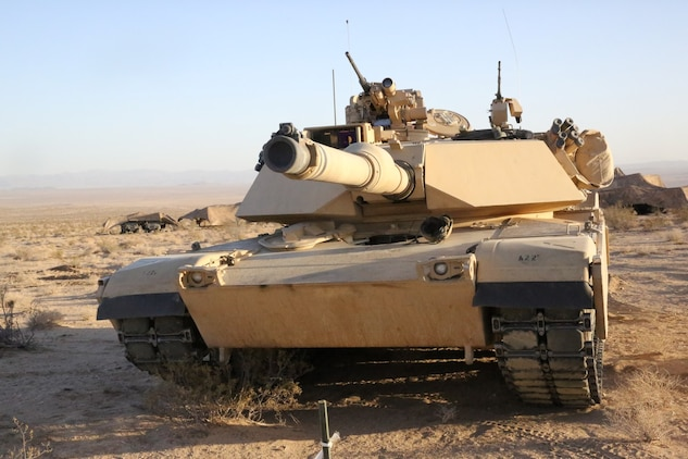 Marines with Alpha Company, 1st Tank Battalion, put their M1A1 abrams main battle tank into a defensive position during Exercise Desert Scimitar aboard Marine Corps Air Ground Combat Center Twentynine Palms, Calif., May 11, 2014. The training gave the Marines the opportunity to refine and rehearse essential combat skills needed in a battlefield environment. Desert Scimitar is an annual exercise that includes elements from the I Marine Expeditionary Force. The exercise focused on conventional operations and provided realistic training that prepared Marines for overseas operations. (U.S. Marine Corps photo by Cpl. Christopher J. Moore/Released)