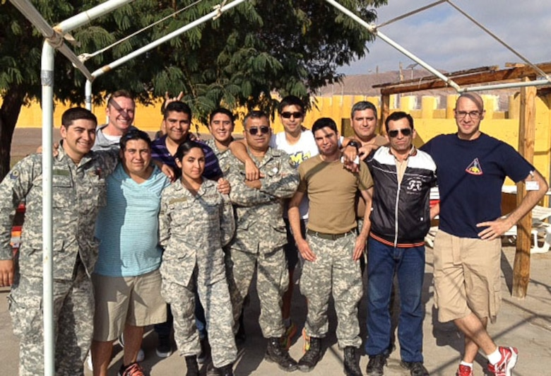 Master Sgt. Jeremy Jacobs, 12th Air Force (Air Forces Southern) Tactical Aircraft Manager, and Staff Sgt. Nicholas Filip, 355th Operational Support Squadron Aircrew Flight Equipment Technician, pose for a photo with members of the Chilean Air Force during a subject matter expert exchange.