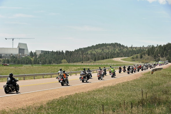 Military and civilian law enforcement members, including Academy Airmen, ride toward the Cadet Chapel March 22 during the 2014 National Police Week Motorcycle Run. The event was designed to show respect for law enforcement officials across the country who have died in the line of duty. (Sarah Chambers/U.S. Air Force photo)