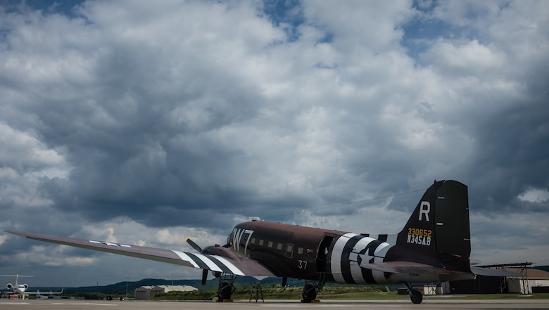 "A Douglas C-47 Skytrain, designated Whiskey 7, sits on the flight line in preparation for events commemorating the 70th anniversary of D-Day in Normandy, on Ramstein Air Base, Germany, May 28, 2014. Whiskey 7 led the legacy squadron that would become the 37th AS, recently returned to mainland Europe and landed at Ramstein Air Base. Whiskey 7 was assigned to the 37th Troop Carrier Squadron as the lead aircraft for the unit and dropped the 3rd Battalion, 505th Parachute Infantry Regiment, 82nd Airborne Division on Drop Zone ""O"" near Sainte-Mere Eglise, France. (U.S. Air Force photo/Airman 1st Class Jordan Castelan)"