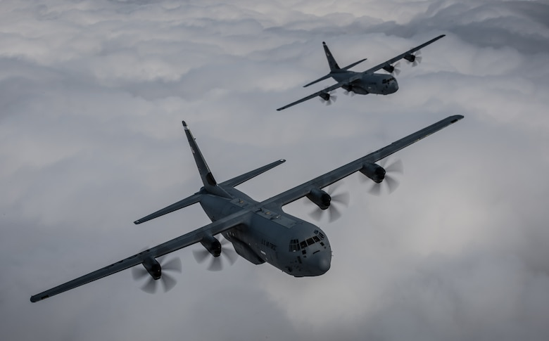 "Two 37th Airlift Squadron C-130J Super Hercules aircraft practice flying in formation in preparation for events commemorating the 70th anniversary of D-Day in Normandy, over Germany, May 27, 2014. A Douglas C-47 Skytrain, known as Whiskey 7 led the legacy squadron that would become the 37th AS, recently returned to mainland Europe and landed at Ramstein Air Base. The C-47 was assigned to the 37th Troop Carrier Squadron as the lead aircraft for the unit and dropped the 3rd Battalion, 505th Parachute Infantry Regiment, 82nd Airborne Division on Drop Zone ""O"" near Sainte-Mere Eglise, France. (U.S. Air Force photo/Airman 1st Class Jordan Castelan)"