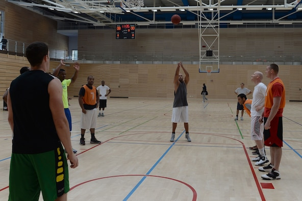 U.S. Air Force Tech. Sgt. Stephan Perryman, 52nd Component Maintenance Squadron program NCO in charge from Colorado Springs, Colo., shoots a free throw during a wing sports day basketball tournament at Spangdahlem Air Base, Germany, May 29, 2014. Wing sports days encourage fitness, unit morale and fun. (U.S. Air Force photo by Senior Airman Alexis Siekert/Released)