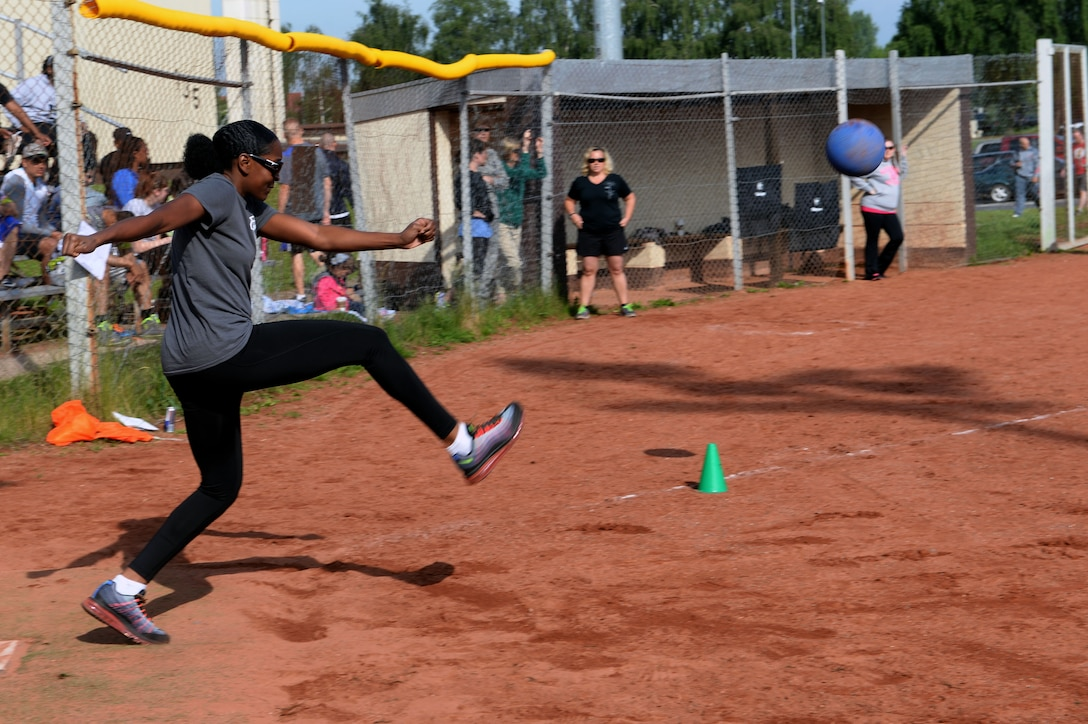 U.S. Air Force Staff Sgt. Imelda Edge, 726th Air Mobility Squadron passenger service supervisor from Houston, drives the ball left during a wing sports day kickball tournament at Spangdahlem Air Base, Germany, May 29, 2014. The base participated in five competitions throughout the day. (U.S. Air Force photo by Senior Airman Alexis Siekert/Released)