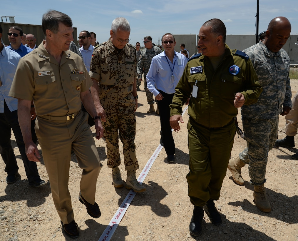 U.S. Navy Adm. Bruce W. Clingan, commander of U.S. Naval Forces Europe, left, listens as Israeli Defense Force Brig. Gen. Shachar Shohat, Air Defense Forces commander, leads a delegation on a tour of Hatzor Air Base, Israel, May 19, 2014. The admiral toured the installation to oversee the progress of Juniper Cobra 14, a bilateral defense exercise. (U.S. Air Force photo illustration by Staff Sgt. Joe W. McFadden/Released)