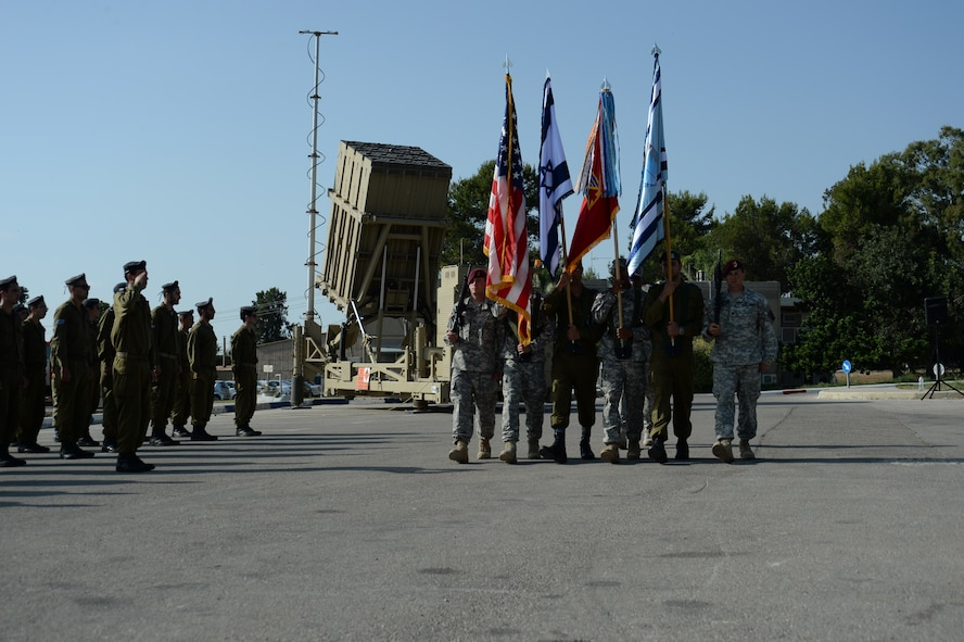 U.S. and Israeli color guard members present their national and service flags during a closing parade ceremony for the Juniper Cobra 14 bilateral exercise at Hatzor Air Base, Israel, May 22, 2014. JC14 is a combined exercise designed to improve interoperability between the two countries' armed forces. (U.S. Air Force photo by Staff Sgt. Joe W. McFadden/Released)