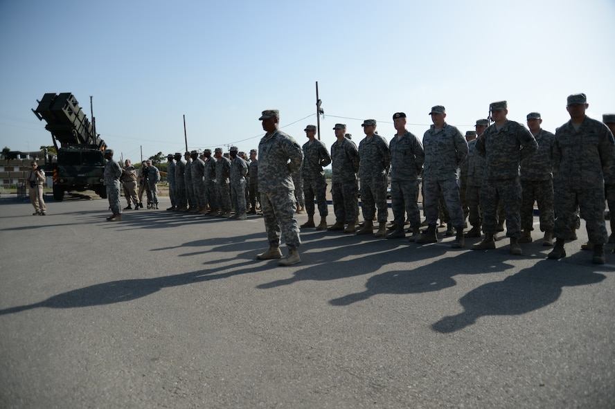U.S. service members stand in formation prior to the start of the closing ceremonies of the Juniper Cobra 14 bilateral exercise at Hatzor Air Base, Israel, May 22, 2014. JC14 is an exercise designed to train combined U.S. and Israeli military forces to respond as a combined force to a regional crisis. (U.S. Air Force photo by Staff Sgt. Joe W. McFadden/Released)