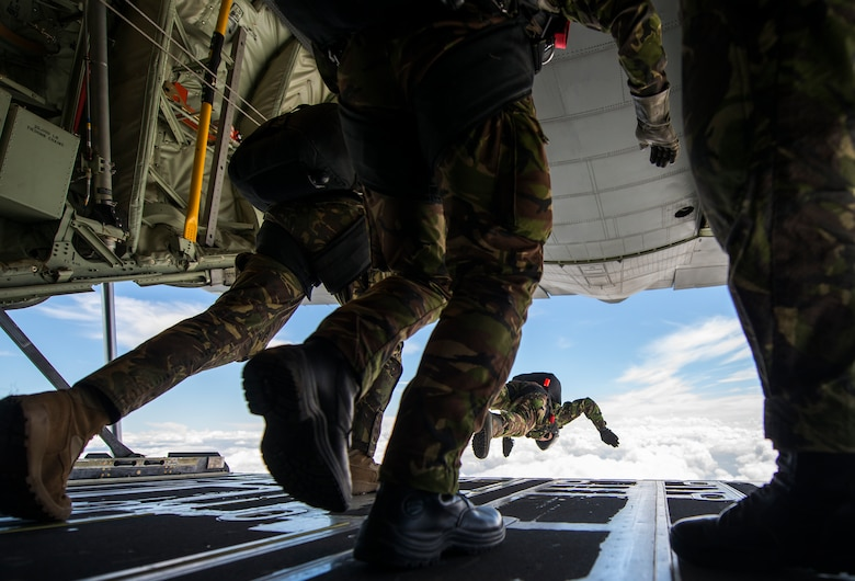 Romanian paratroopers perform a high-altitude, low-opening jump out of a U.S. Air Force C-130J Super Hercules during exercise Carpathian Spring, May 18, 2014, above Campia Turzii, Romania. C-130J pilots, loadmasters and Army jumpmasters worked together with Romanian paratroopers to ensure their safety during static-line and HALO jumps from the aircraft above Romanian drop zones. (U.S. Air Force photo/Senior Airman Damon Kasberg)