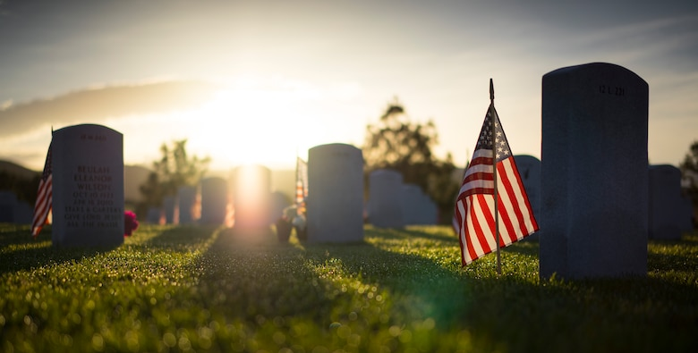 Dawn breaks over the Idaho State Veterans Cemetery on Memorial Day, May 26, 2014, in Boise, Idaho. Local dignitaries held a Memorial Day Ceremony there later that day. (U.S. Air Force photo/Tech. Sgt. Samuel Morse)