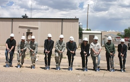KIRTLAND AIR FORCE BASE, N.M., -- The District participated in breaking ground on the FY13 Building 909 Lab Space at the base May 28, 2014. Among the AFRL, KAFB, and contractor representatives Deputy District Commander Maj. Gary Bonham, second from left; Kirtland Resident Office Project Officer Capt. John Deal, third from left; and project manager Filemon Gallegos, second from right.