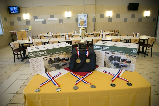 Marine Corps Air Station Beaufort food service specialists compete in the Mess Hall Cook-Off held at the Consolidated Mess Hall on Marine Corps Recruit Depot Parris Island, May 20. To compete in the biannual competition, the Marines needed to complete the Culinary Foundations Course and have one of the top four scores in the class. The Cook-off was held to teach the cooks how to think creatively and use their knowledge to create unique recipes.