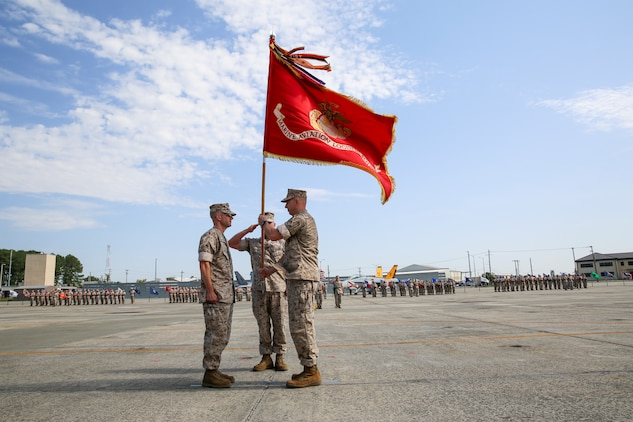 Lieutenant Colonel Branden G. Bailey (right), passes the organizational colors to Lt. Col. Michael Margolis (left) during a change of command ceremony for Marine Aviation Logistics Squadron 31 aboard Marine Corps Air Station Beaufort, May 22.