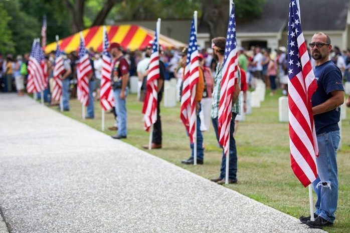 Active duty service members, veterans, and family members from all walks of life participate in the 2014 Beaufort, S.C., Memorial Day parade and Ceremony at the Beaufort National Cemetery in Beaufort, S.C., May 26, 2014. The ceremony was held in remembrance of the many military service members who gave the ultimate sacrifice. (U.S. Marine Corps photo by Cpl. Aneshea S. Yee/Released)