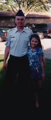 Airman Basic Keith Connella stands with his sister Ashley at his Basic Military Training graduation ceremony March 12, 2000. (Courtesy photo)