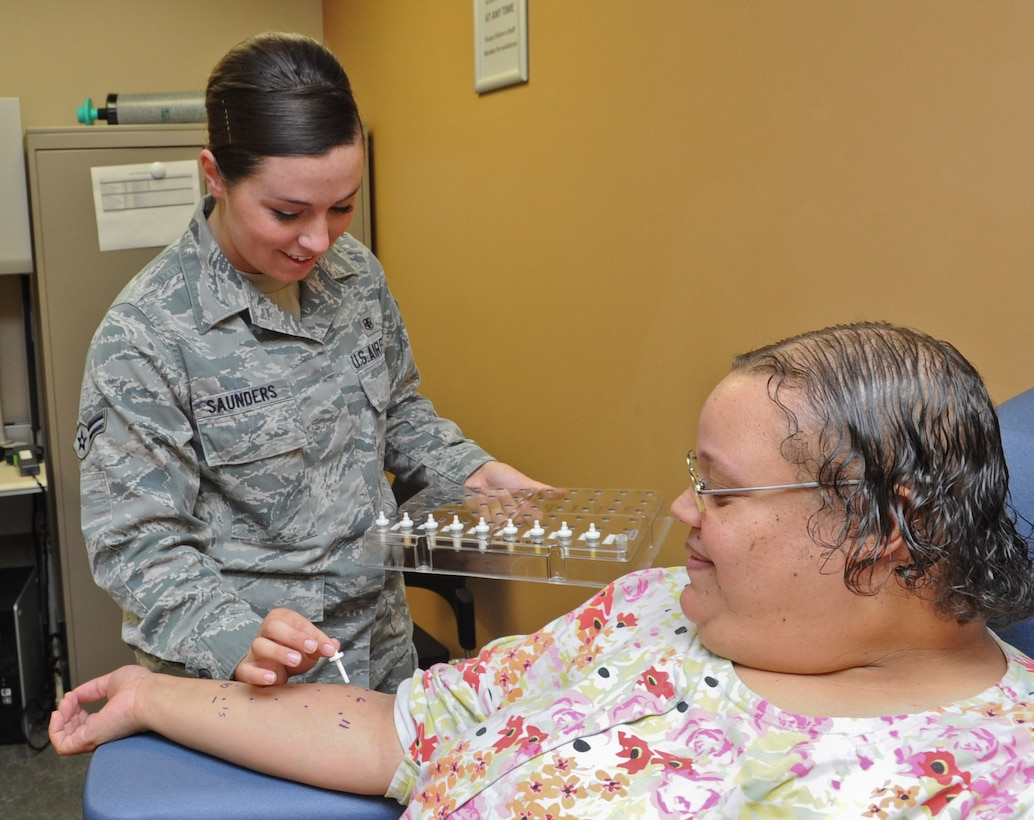 Airman 1st Class Cassandra Saunders, 56th Medical Operations Squadron allergy immunization technician, gives an allergy test to Katina Fritsch, 56th MDOS advance office clerk, May 12 at Luke Air Force Base. (U.S. Air Force photo/Airman 1st Class Cory Gossett)