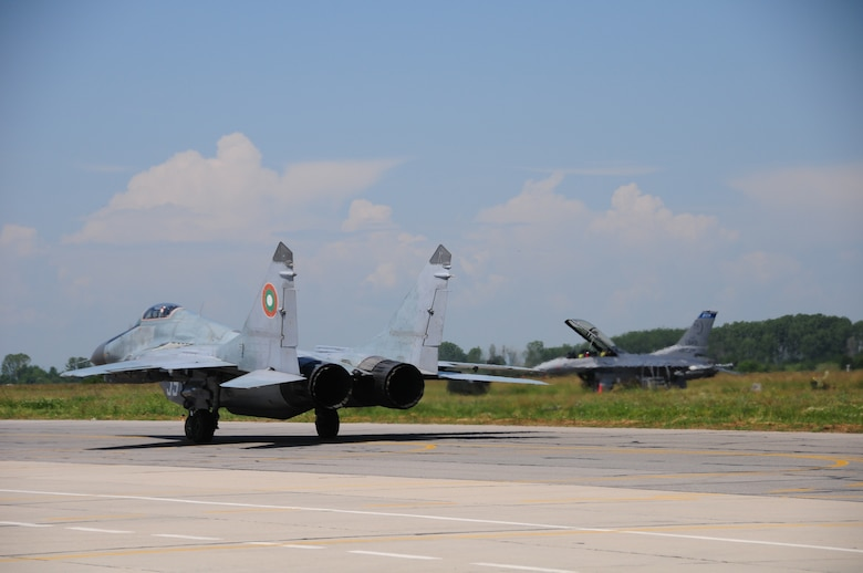 A Bulgarian MiG-29 taxis in front of a 148th Fighter Wing, Minnesota Air National Guard F-16 during Thracian Star 2014. The event is a yearly Bulgarian exercise that has been held since 2005. (U.S. Air Force photo/ Capt. Jodi Kiminski)