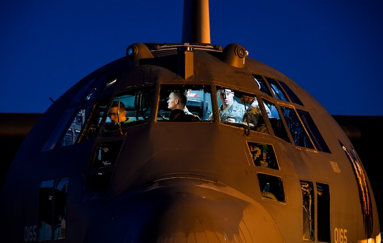 Flight control specialist journeymen from the 4th Aircraft Maintenance Unit work on an AC-130U Spooky Gunship  at Hurlburt Field, Fla., May 16, 2014. The 4th AMU maintains the aircraft 24 hours a day to ensure the training missions go as planned. (U.S. Air Force photo/Senior Airman Christopher Callaway)
