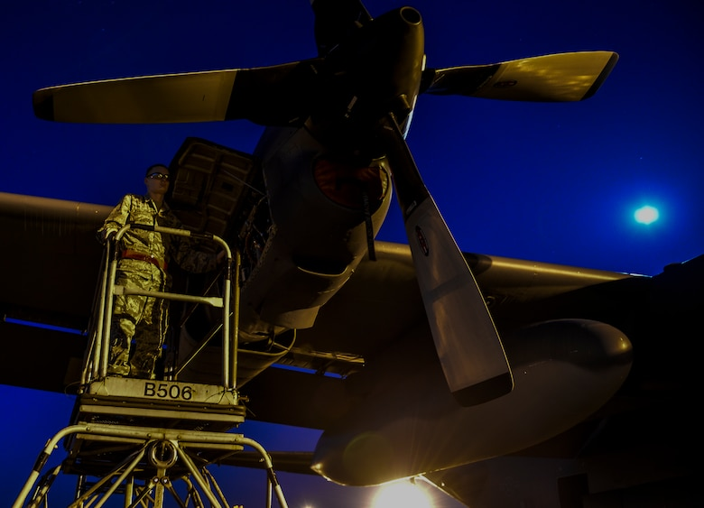 Airman 1st Class Eric Campbell, 4th Aircraft Maintenance Unit aerospace propulsion journeyman, works on an AC-130U Spooky Gunship at Hurlburt Field, Fla., May 16, 2014. The 4th AMU helps generate approximately 1000 training missions annually for the Spooky. (U.S. Air Force photo/Senior Airman Christopher Callaway)