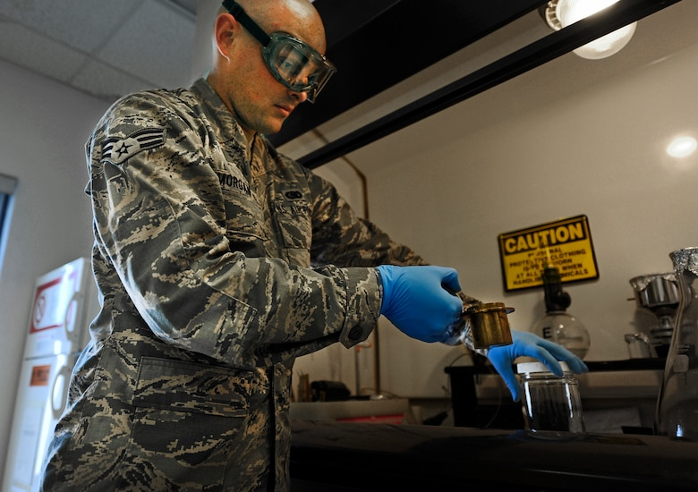 Senior Airman Johnathan Morgan, 1st Special Operations Logistics Readiness Squadron fuels journeyman, checks fuel for quality at Hurlburt Field, Fla., May 20, 2014. The petroleum, oils and lubricants flight is responsible for testing the fuel they receive before distributing it throughout the base. (U.S. Air Force photo/Staff Sgt. Jeff Andrejcik)