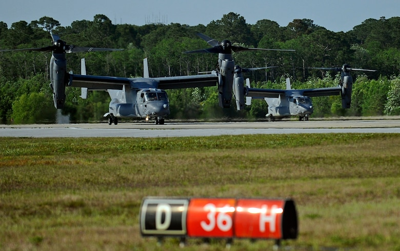CV-22 Osprey's taxi at Hurlburt Field, Fla. May 20, 2014. The Osprey, left, had to be refueled prior to its training mission. (U.S. Air Force photo/Staff Sgt. Jeff Andrejcik)