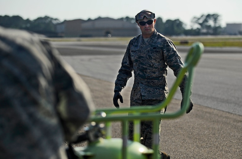Senior Airman Johnathan Morgan, 1st Special Operations Logistics Readiness Squadron fuels journeyman, prepares equipment for a refuel at Hurlburt Field, Fla., May 20, 2014. The Petroleum, Oils and Lubricants flight is responsible for transporting and dispensing thousands of gallons of fuel weekly at Hurlburt Field. (U.S. Air Force photo/Staff Sgt. Jeff Andrejcik)