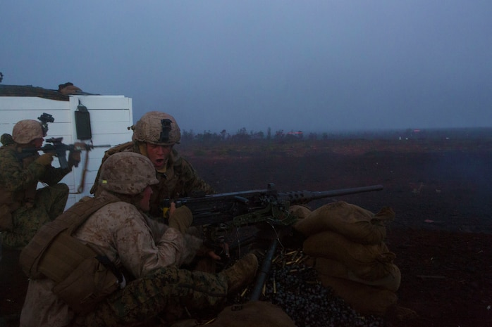 Marines with Weapons Company, 3rd Battalion, 3rd Marine Regiment fire a .50-caliber rifle during a live fire shoot here, May 28. The Marines were being tested on whether they could keep security throughout the night and effectively fire upon targets.
