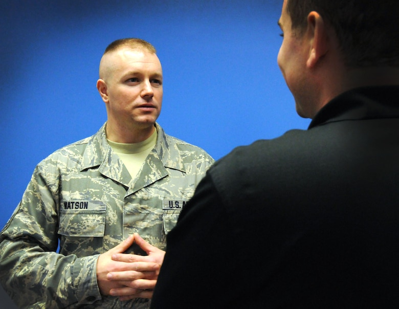 Master Sgt. Kevin Watson, 111th Attack Wing recruiting office supervisor, talks with student flight member Ryan Sweet during drill Nov. 1, 2014, at Horsham Air National Guard Station, Horsham, Pa. Watson earned the fiscal year 2014 award for Recruiting Office Supervisor of the Year. (U.S. Air National Guard photo by Tech. Sgt. Andria J. Allmond/Released)