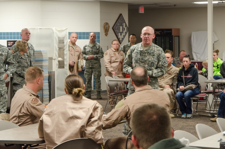 U.S. Army Maj. Gen. K. Luke Reiner addresses U.S. Air Force Airmen from the 153rd Airlift Wing, Wyoming Air National Guard.  Guard members representing operations, maintenance, medical and logistics deployed in support of the Overseas Contingency Operations in Southwest Asia. The Wyoming Air National Guard Airmen and aircraft are relieving members of the 130th Airlift Wing, Charleston West Virginia. (U.S. Air National Guard photo by Tech. Sgt. John Galvin/released)