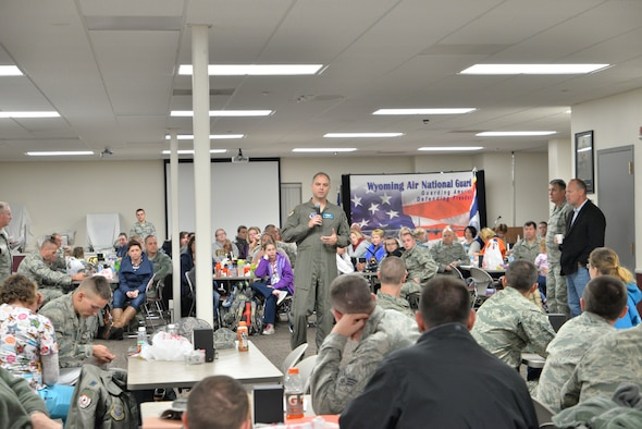U.S. Air Force Col. Bradley Swanson, Commander, 153rd Airlift Wing, Wyoming Air National Guard addresses Guard members prior to their deployment. Airmen from operations, maintenance, medical, and logistics deploy in support of the Overseas Contingency Operations in Southwest Asia. The Wyoming Air National Guard Airmen and aircraft are relieving members of the 130th Airlift Wing, Charleston West Virginia. (U.S. Air National Guard photo by Master Sgt. Charles Delano/released)
