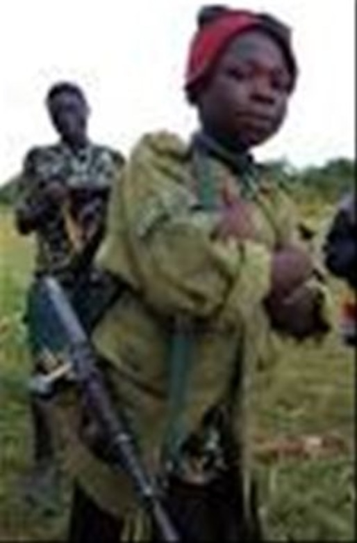 human trrafficking child soldiering picture, image provided by http://www.warchild.org.uk/issues/child-soldiers