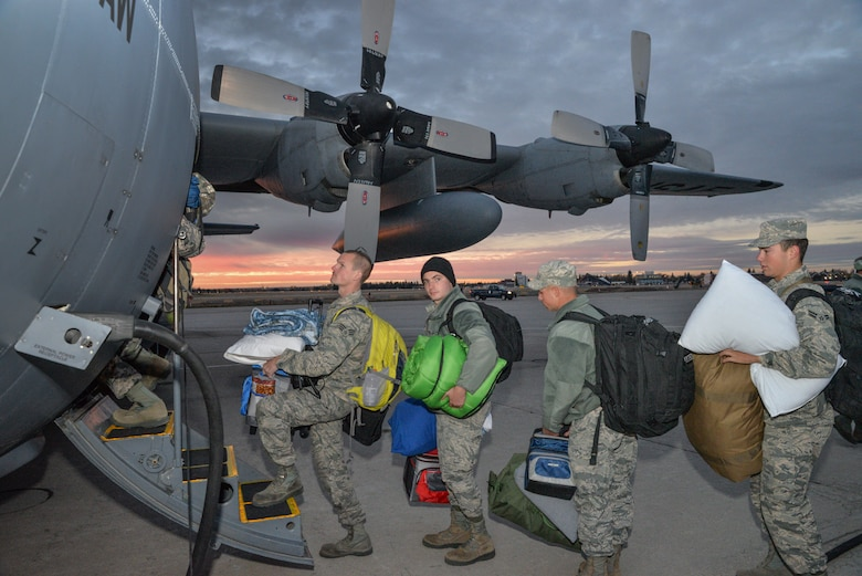 U.S. Air Force Airmen from the 153rd Airlift Wing, Wyoming Air National Guard board a C-130H Hercules aircraft. Maintenance, Operations, and Logistics airmen deploy in support of the Overseas Contingency Operations in Southwest Asia. The Wyoming Air National Guard Airmen and aircraft are relieving members of the 130th Airlift Wing, Charleston West Virginia. (U.S. Air National Guard photo by Master Sgt. Charles Delano/released)