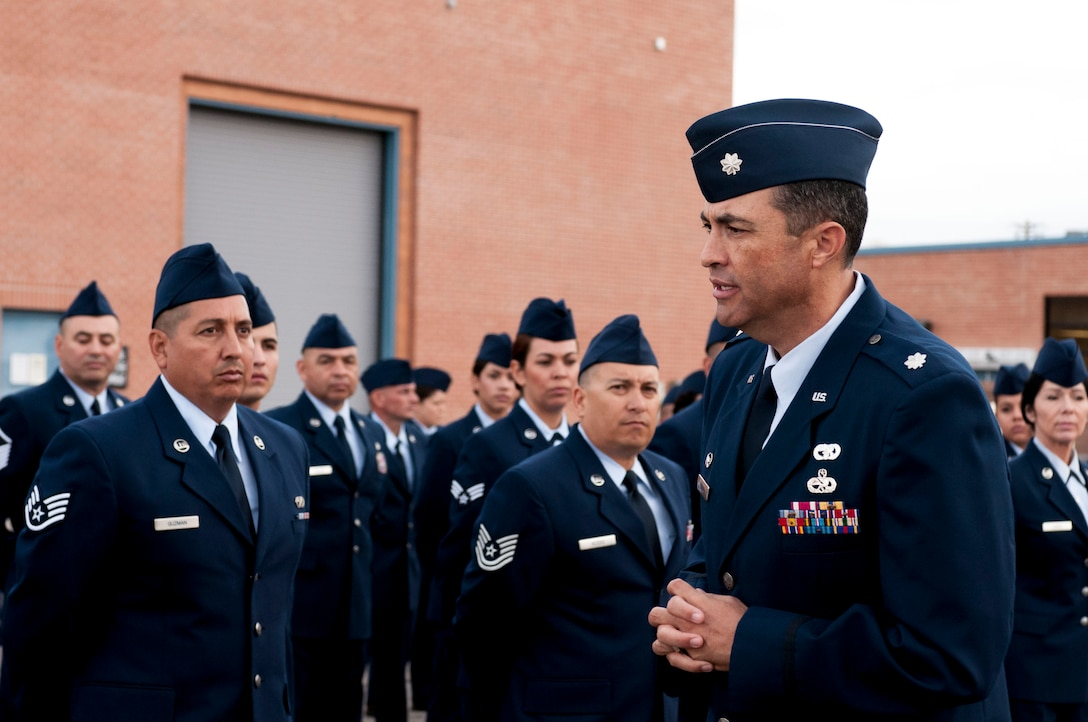 Lt. Col. Fausto Padilla, 162nd Logistics Readiness Squadron commander, confers with Airmen after a successful open ranks inspection on Nov. 2 at the Tucson International Airport. More than 70 Airmen assembled near building 6 in their dress blues, where Senior Master Sgt. Daniel Ramirez inspected the crew for hygiene and uniform appearance while ensuring their medals and uniforms were in line with military personnel flight records. (U.S. Air National Guard photo by Tech. Sgt. Hollie A. Hansen/Released)