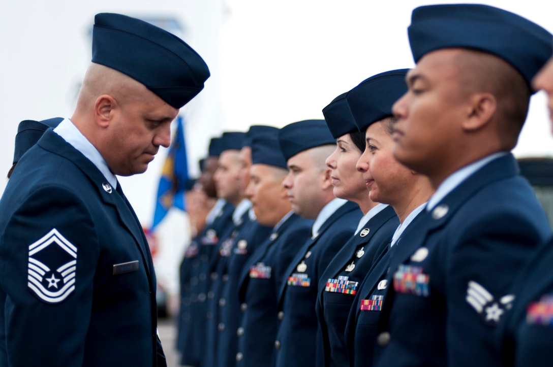 """Keeping that guard up. By means of an open ranks inspection, Senior Master Sgt. Daniel Ramirez reviews Airmen from the 162nd Logistics Readiness Squadron on Nov. 2 at the Tucson International Airport. """"As the new LRS superintendent, it's my duty to always instill the squadron with pride and professionalism,"""" said Ramirez. (U.S. Air National Guard photo by Tech. Sgt. Hollie A. Hansen/Released)"""