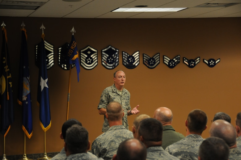 Brig. Gen. Bryan Fox, Monatana Air National Guard commander, addresses a group of 120th Airlift Wing Airmen prior to the September Unit Training Assembly Sept. 6, 2014. 
