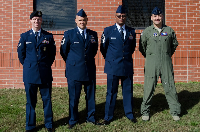 U.S. Air Force Airmen pose outside the Advanced Airlift Tactics Training Center, Rosecrans Air National Guard Base, after a ceremony recognizing them as Outstanding Airmen of the Year, Nov. 1, 2014.  From left, Senior Airman Gregory Haynes, Master Sgt. Kris Neros, Chief Master Sgt. Joseph Hamlett, Capt. Jared Kirk.  Not pictured - Technical Sgt. Fred Osborn.