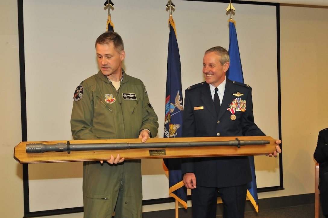"Col. Theodore ""Limpy"" Limpert is being presented with the barrel of his F-16 of which he flew over 2200 hours, prior to his retirement after 30 years of service on Nov. 1, 2014 at the 174th Attack Wing in Syracuse, NY. Limpert had an illustrious career as a pilot, piloting the A-10 and F-16 for the U.S. Air Force. (New York Air National Guard Photo Tech. Sgt. Justin A. Huett/Released)"