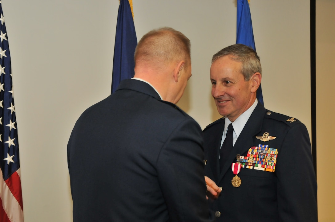 "Col. Theodore ""Limpy"" Limpert is being presented with a Meritorious Service Medal prior to his retirement after 30 years of service on Nov. 1, 2014 at the 174th Attack Wing in Syracuse, NY. Limpert had an illustrious career as a pilot, piloting the A-10 and F-16 for the USAF. (New York Air National Guard Photo Tech. Sgt. Justin A. Huett/Released)"