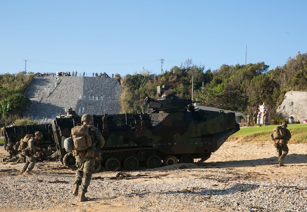Marines disembark Assault Amphibious Vehicles during a simulated assault Nov. 1 at Oura Wan Beach, Camp Schwab, Japan. The assault is part of Blue Chromite 2014, an exercise that demonstrates the Navy and Marine Corps' amphibious and expeditionary capabilities from the sea. The Marines are with 2nd Battalion, 9th Marine Regiment, currently assigned to 4th Marine Regiment, 3rd Marine Division, III Marine Expeditionary Force under the unit deployment program. The AAVs are with Combat Assault Battalion, 3rd Marine Division.